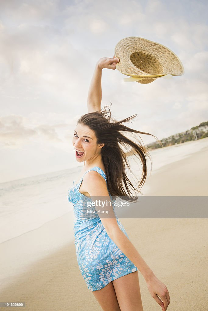 Caucasian woman playing on beach : Foto stock