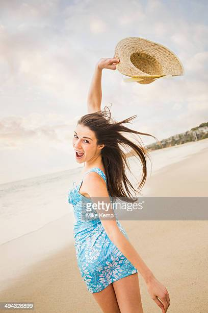 Caucasian woman playing on beach