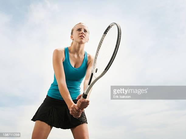 Caucasian woman playing tennis