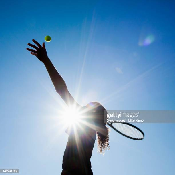 caucasian woman playing tennis - serving sport stock pictures, royalty-free photos & images