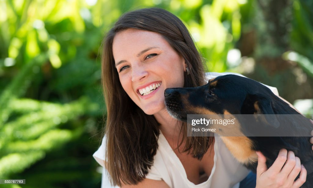 Caucasian woman playing with dog outdoors : Foto stock