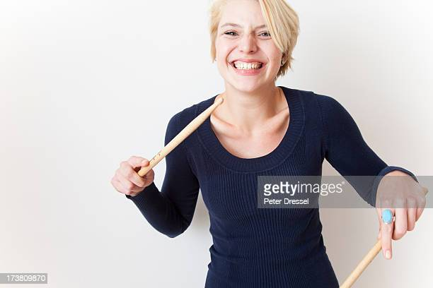 Caucasian woman playing with drumsticks