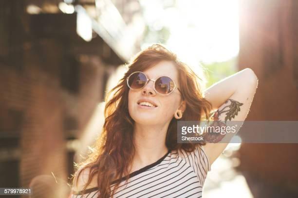 Caucasian woman posing in city