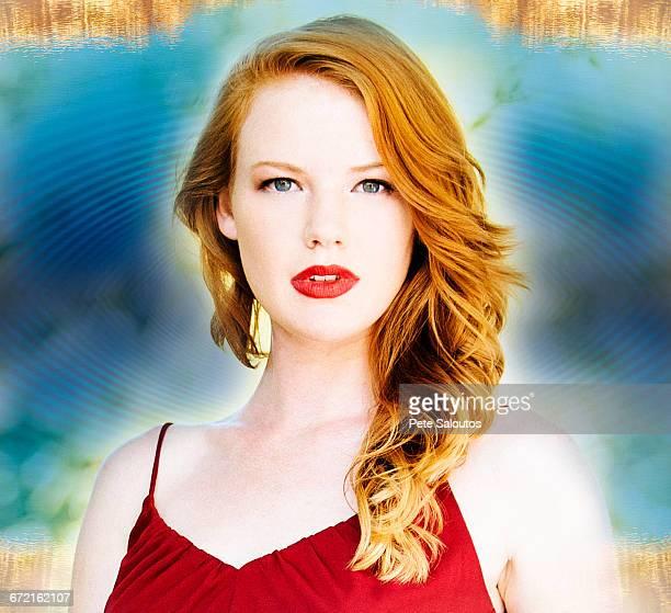 Caucasian woman posing in mysterious blue aura