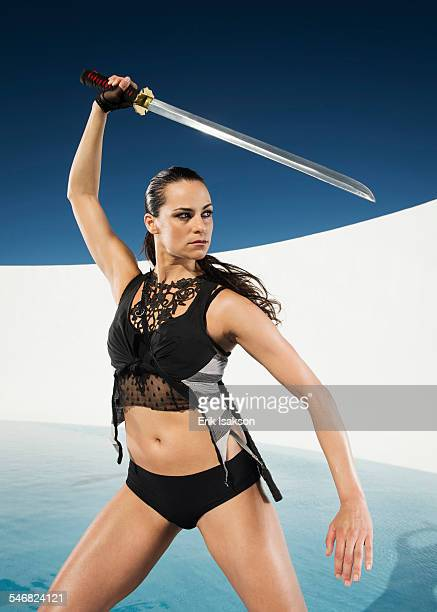 Caucasian woman posing with sword
