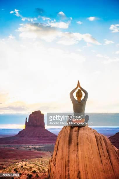 Caucasian woman practicing yoga in Monument Valley, Utah, United States