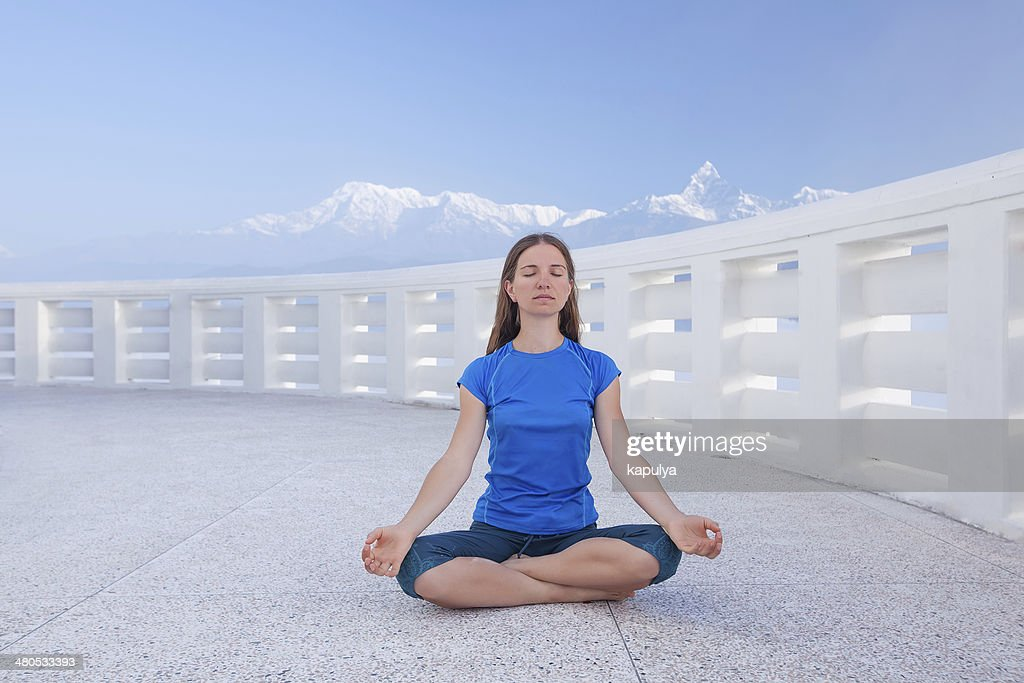 Caucasian woman practicing yoga : Stock Photo