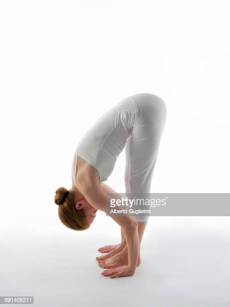 caucasian woman practicing yoga - older woman bending over stock pictures, royalty-free photos & images
