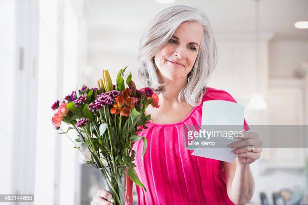 Caucasian woman receiving bouquet of flowers