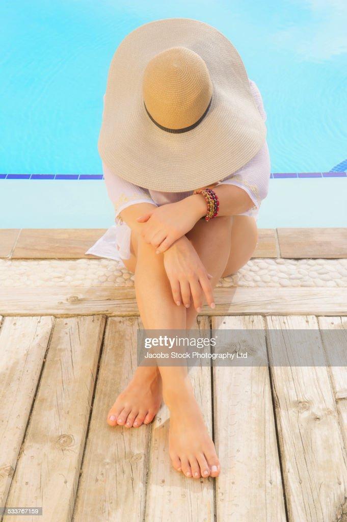 Caucasian woman relaxing near swimming pool : Foto stock