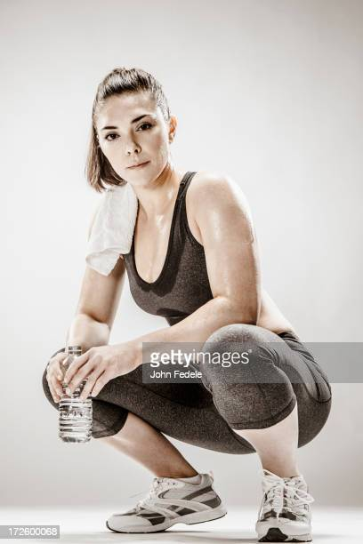 Caucasian woman resting after workout
