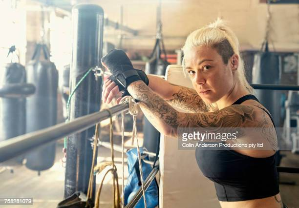 caucasian woman resting in boxing ring - mixed boxing stock photos and pictures
