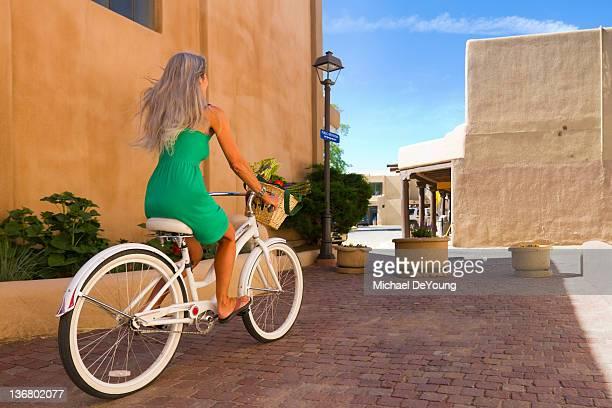 Caucasian woman riding bicycle