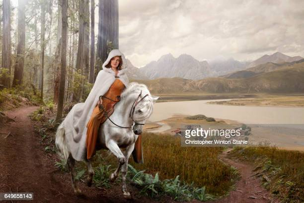 caucasian woman riding horse in remote forest - flowing cape stock pictures, royalty-free photos & images