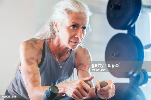 Caucasian woman riding stationary bicycle