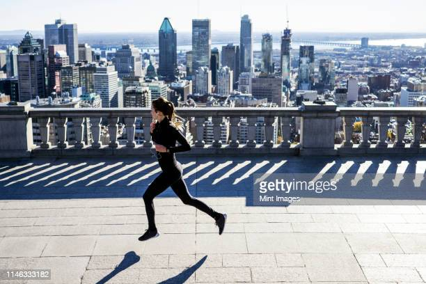 caucasian woman running in city - montréal stock pictures, royalty-free photos & images