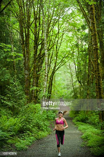 caucasian woman running on remote path - bainbridge island stock pictures, royalty-free photos & images
