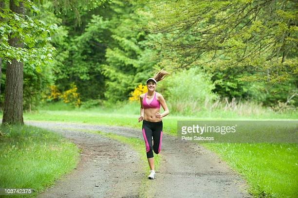 caucasian woman running on remote path - kitsap county washington state stock pictures, royalty-free photos & images