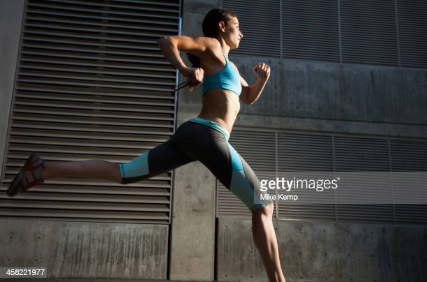 caucasian woman running - striding stock pictures, royalty-free photos & images