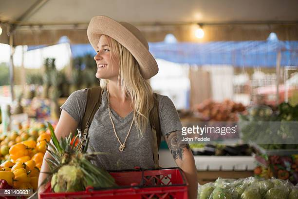 caucasian woman shopping for produce in farmers market - farmers market stock pictures, royalty-free photos & images