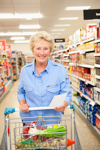 Caucasian woman shopping in grocery store - gettyimageskorea