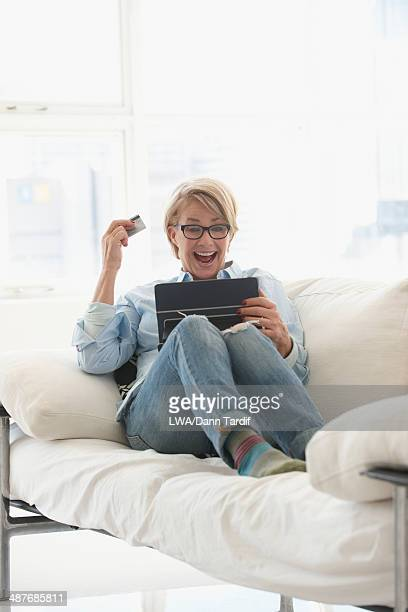 Caucasian woman shopping on digital tablet
