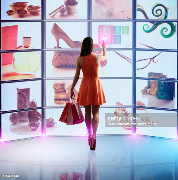 caucasian woman shopping online - touch sensitive stock pictures, royalty-free photos & images