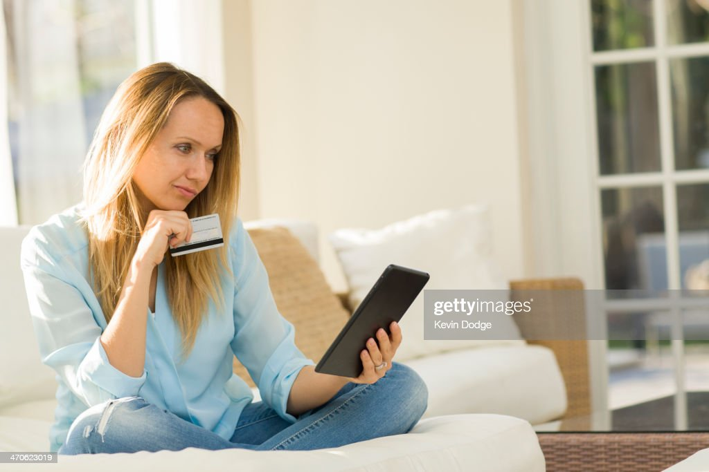Caucasian woman shopping online with digital tablet : Stock Photo