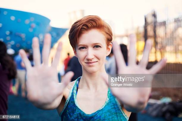 Caucasian woman showing palms of hands