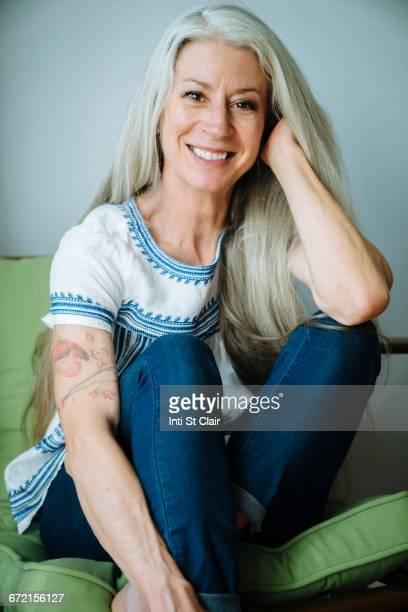 Caucasian woman sitting in armchair