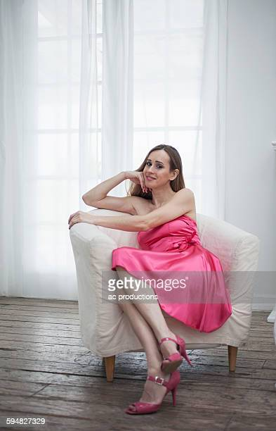 caucasian woman sitting in chair - strapless dress stock pictures, royalty-free photos & images
