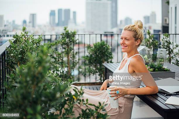 Caucasian woman sitting on balcony