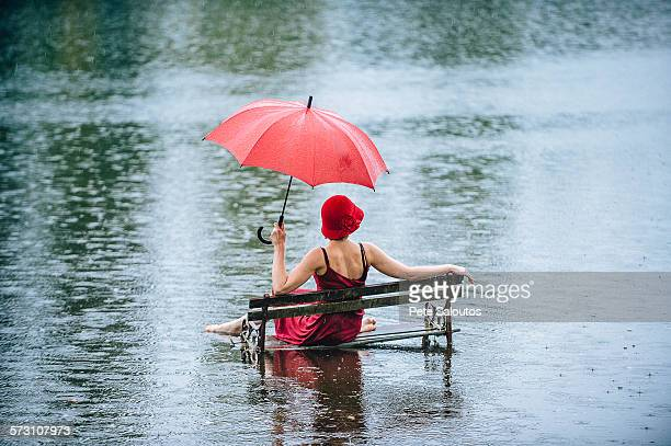 Caucasian woman sitting on bench in flood