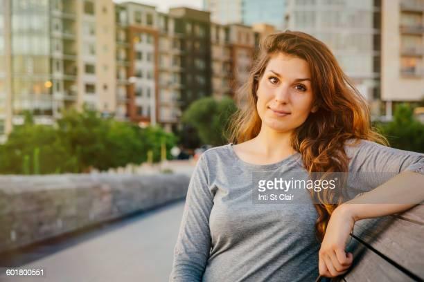 Caucasian woman sitting on bench