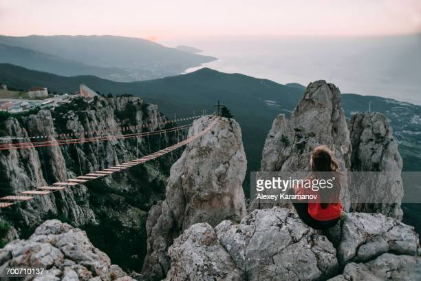 caucasian woman sitting on mountain near footbridge - crimea stock pictures, royalty-free photos & images