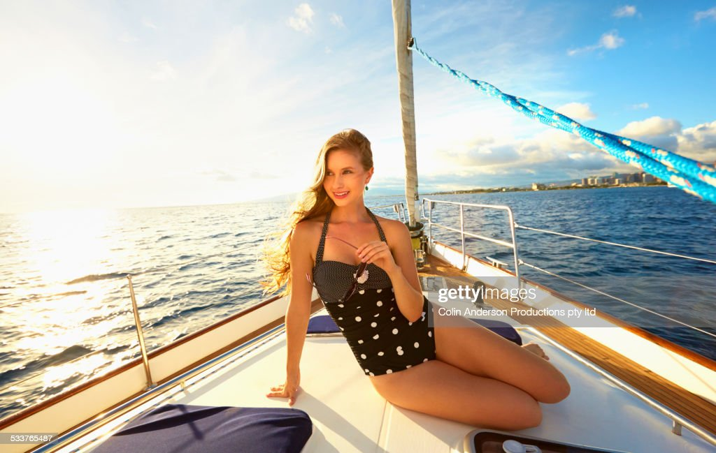 Caucasian woman sitting on yacht deck : Foto stock