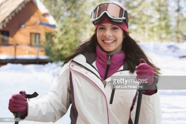 Caucasian woman skiing in snow