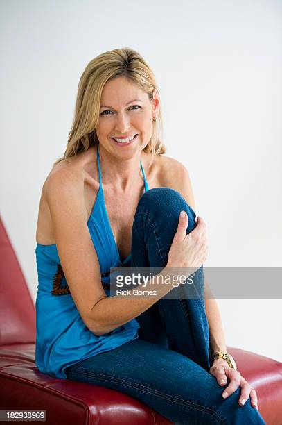 Caucasian woman smiling in chair