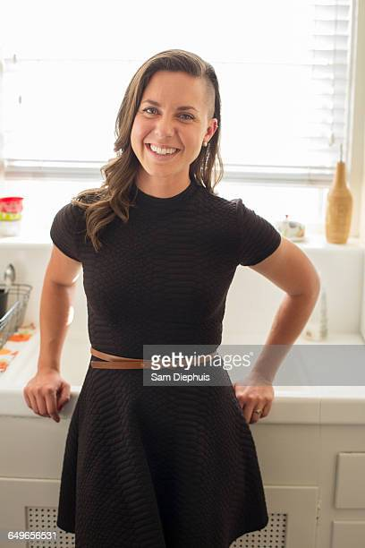 caucasian woman smiling in kitchen - half shaved hairstyle stock pictures, royalty-free photos & images