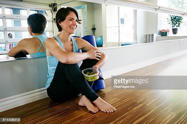 Caucasian woman smiling in yoga studio