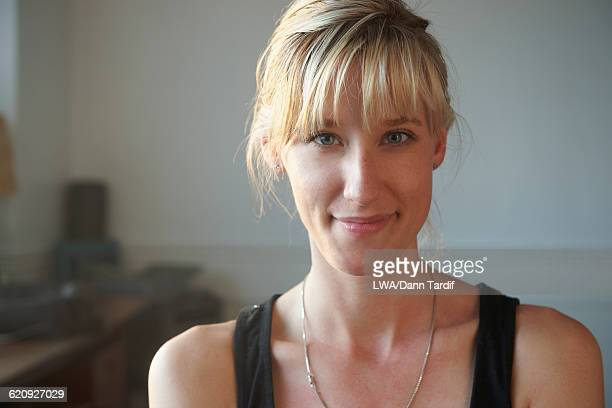 Caucasian woman smiling indoors