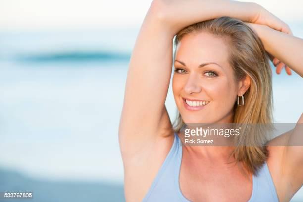 Caucasian woman smiling on beach