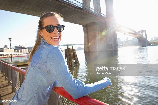 Caucasian woman smiling on waterfront, New York, New York, United States