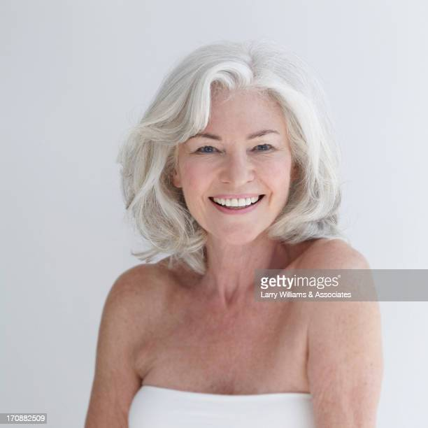 caucasian woman smiling - grey hair stock photos and pictures