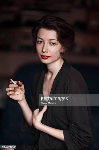 Caucasian woman smoking indoors