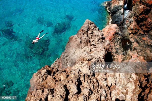 Caucasian woman snorkeling in ocean