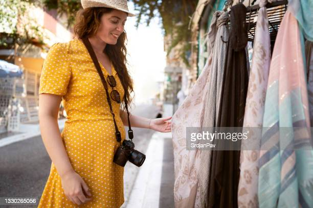 caucasian woman, solo tourist, shopping on the street markets in vasiliki, on the island of levkas, greece. - neckwear stock pictures, royalty-free photos & images