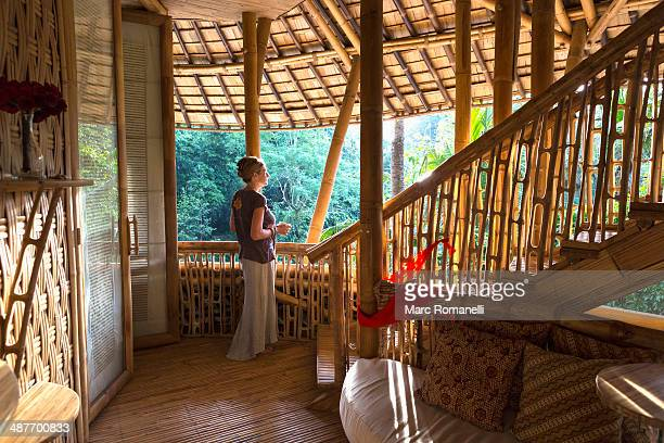 caucasian woman standing in bamboo room, ubud, bali, indonesia - eco tourism stock pictures, royalty-free photos & images