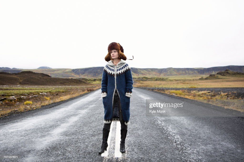 Caucasian woman standing in middle of road : Stock Photo