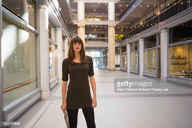 Caucasian woman standing in shopping mall